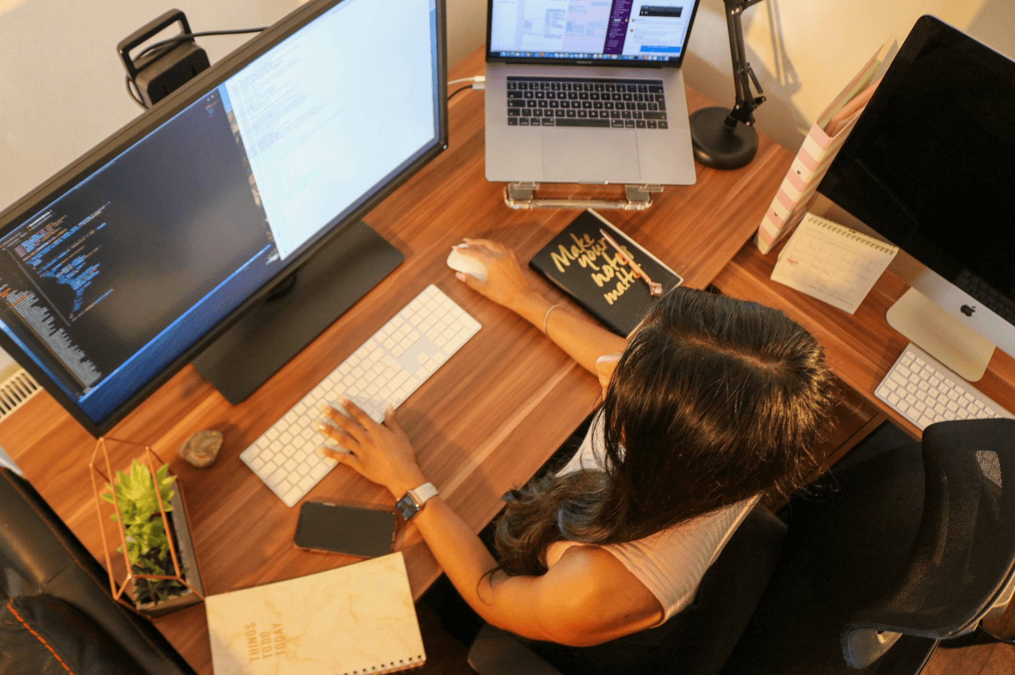 Arial shot of Simeron working at her desk